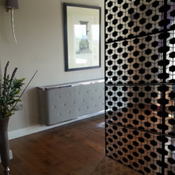 black-geodots-laser-cut-metal-screen-in-piano-room-with-shadow